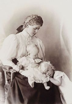 Crown Princess Marie of Romania (born Princess Marie of Saxen-Coburg and Gotha) with her two oldest children Carol and Elisabeth. Missy with her oldest darlings