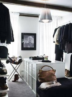 Walk in closet. Centerpiece uses ikea shelves.