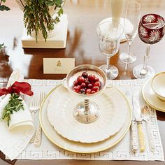 This napkin idea can be adapted to suit any celebration or season. Tie pretty red silk ribbon in a simple knot, then adorn with a sprig of greenery.