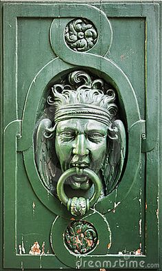 Door Knocker on Wooden Door, In Paris