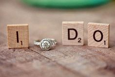 It would be cute to do a photo with each ring and put them in a double picture frame.