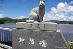 "A majestic stone statue of the ""Iriomote Neko"" (Iriomote wildcat) on Iriomote Island, Okinawa."