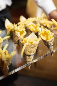 Fries in Mini Cones (Cute!)   Photography: Perez Photography. Read More:  http://www.insideweddings.com/weddings/incredible-tented-ceremony-barn-reception-at-ranch-in-aspen/860/