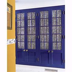 Complements: Yellow-Orange and Blue-Violet    Bright colors can breathe new life into traditional woodwork and work especially well in casual living areas. Here, glossy violet-blue pantry doors in a mudroom pop against the yellow-orange of the adjacent wall. When working with more saturated hues, remember that the colors will often appear more intense on the walls than they do on the strip.    Next