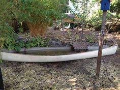 Fill an old canoe with water for a great duck pond.