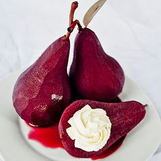 Wine-poached pears with vanilla bean mascarpone filling. I have gorgeous vanilla beans that I can do this with!