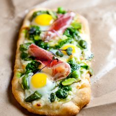 Pile spring's best greens onto homemade pizza dough and then layer with robiola, prosciutto and quail eggs. From Zen Can Cook, found at www.edamam.com.