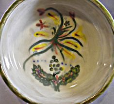 Bowls are the ultimate multi-purpose dinnerware. We eat soup, stew, cereal, salad, dips, chips etc out of them. But why not eat out of something with a little more style and flair. This celticly inspired hand thrown, hand painted and hand glazed bowl is sized for all the above. Hand
