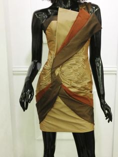 Tube dress with drape and floral cut off applique by Rani Patrice