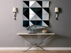 TOKYO MIRROR  Multi faceted mirror made from polished stainless sheet. Each module is 300mm x 300mm  Dimensions: 1200 x 1200  Finishes: Mirror polished stainless steel