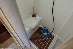 The couple don't have to go elsewhere to use the bathroom, as the van comes complete with a small toilet and shower cubicle