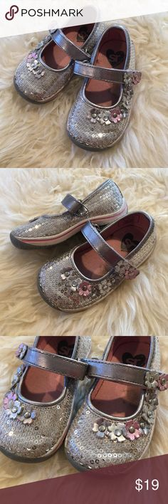 Stride Rite silver sequin sneakers mary jane 5.5 Adorable sequin sparkly sneakers. Only worn a couple times. My daughter just doesn't like them so I'm making room for new ones. Rubber sole and velcro strap. Size 5.5. Bundle and save with other items from my closet. Happy shopping! Stride Rite Shoes Sneakers