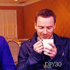 The way he holds that cup of coffee and shy smile.  *sigh* .gif