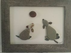 No Stone Unturned- Pebble Art Two dogs playing with ball. Created by Dawn