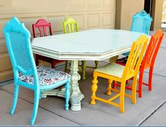 I probably wouldn't go this bright, but I think the idea of having mismatched, different colored dining room chairs is fun!