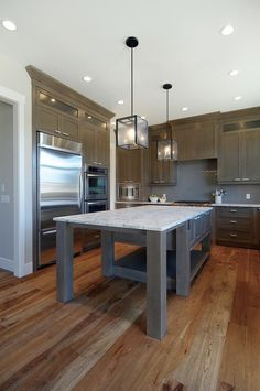 Elegant artcraft lighting in Kitchen Contemporary with Hickory Floors next to…