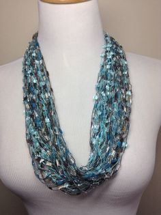 Several strands of blue trellis yarn were wound together to make this yarn necklace.
