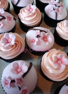 You can have some cherry blossons cupcakes matching the beautiful center pieces.