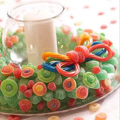 Candied Candle.  Decorate a foam wreath shape with fun gummy candies.  Use toothpicks to secure the treats until the foam is completely covered.  Tie a licorice bow for an edible accent.  For a pretty centerpiece, sit the wreath on a silver platter and place a candle inside.