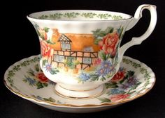 This cute teacup and saucer by Royal Albert, England is in the Warwickshire pattern in the English Country Cottages series with gold trim. The cup is 3 inches high and the saucer is 5.5 in diameter. T