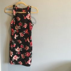 Black and Floral Dress!! This dress is super cute and slim! It has only been worn once or twice! it goes down to about mid thigh-maybe a little lower! size small :) Forever 21 Dresses Midi
