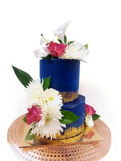 Custom made two tiers blue & gold cake with white flowers and pink roses By Passiontree Velvet