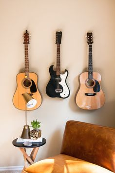 Beautiful guitar corner with gorgeous accent chair and side table Hang Guitar On Wall, Guitar Display Wall, Guitar Room, Home Music Rooms, Home Studio Music, Music Corner, Chill Room, Bedroom Corner, Style Deco