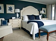 """In this Master bedroom, I painted just 1 wall Benjamin Moore's """"Hale Navy"""" to add a little pop!"""