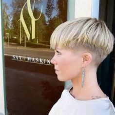 extreme bowl cut women with shaved nape blond pixie