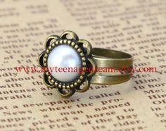 vintage style Peeta's Pearl adjustable sunflower Ring via Etsy.