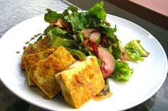 """Curry Fried Tofu Salad shared by The Sexy Vegan *Brian Patton* A big thank you to Brian Patton, aka The Sexy Vegan, for sharing this super yummy vegan salad """"with a kick"""" recipe with us!  Brian says, """"Food should appeal to all five senses. And this salad is a perfect example of something that stimulates sight, smell, texture, and taste, and if you listen really closely, it gives you great decorating tips.""""  We're glad to have a recipe for a vegan salad that has some texture and tingle!"""