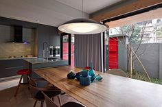 Design studio and residence in Taipei - love that red door!
