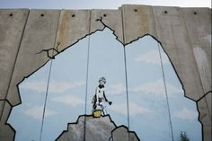 """Art Attack"" made by the British, guerrilla, graffiti artist Banksy is seen on Israel's highly controversial West Bank barrier in Ramallah on August Street Art Banksy, Banksy Graffiti, Bansky, Motels In Los Angeles, West Bank Wall, Aids In Africa, Johannes Vermeer, International Artist, Graffiti"