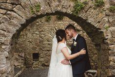 Bride and Groom kissing under castle arch at the Claregalway Castle  Photography by Alex Zarodov Wedding Gallery, Wedding Blog, Wedding Planner, Civil Ceremony, Wedding Ceremony, Bride Speech, Romantic Times, Wedding Brochure, Best Wedding Venues