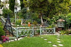 """Design inspiration for the lackluster lot came not from a high-priced consultant but from garden tours and clippings from magazines. Through these, Brigitte came to realize that high-style gardens with a limited array of plants and materials don't appeal to her nearly as much as gardens with more going on. """"I love romantic gardens that have a lot of stuff,"""" she says, meaning yards with distinct garden rooms furnished with architectural accents and a wide range of plants. """"..."""