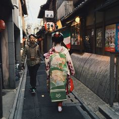 """""""Managed to snap a photo of a Maiko walking in Pontocho today"""""""