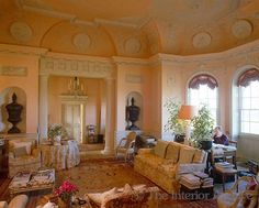 pale apricot walls in this formal drawing room with charming niches, skirted table, pillars, bas reliefs ~ Gervase Jackson Stops