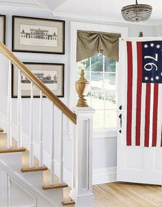 A vintage-style American flag welcomes visitors to this renovated Federal-era house.