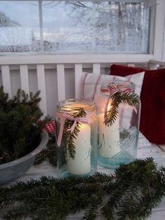 Christmas vignette with greenery and candle lanterns!!! Bebe'!!! Nice due oration for a front porch on a bench or table!!!