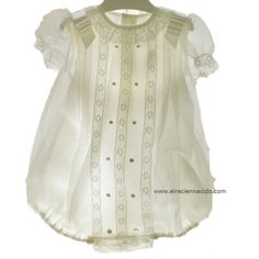 Baby romper with lace down the front.