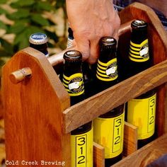 I find inspiration in this...Rustic Wooden Six-Pack Holder