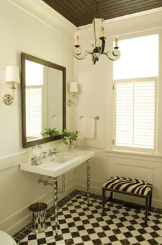I love this bathroom!  The checkerboard tiles and dark ceiling with the white paint is fabulous!!