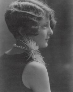 Flapper  -  My Grandmother wore her hair like this back in the day.  So pretty!