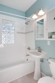 tile shower, glass block window, bare walls