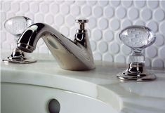 Love the clear handles and white penny tile with white grout