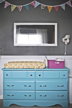 LOVE LOVE LOVE this dresser...the color, the lines, the pop of pink and yellow on top--this is a must for the nursery!