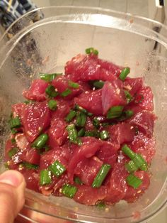 Ahi Tuna Poke    This is one of my FAVORITE foods. Hawaiian style ahi poke.     I chopped up two tuna steaks  Green onion  Minced onion  Minced garlic  Soy sauce (measured with love)  2 table spoons of sesame oil     Then mix it all up and chill for 20 or 30 min.     Oh and make sure the tuna you purchase is sashimi grade and fresh     Enjoys my friends    -G