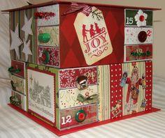 Poster: JeanFB    	 	This is an advent box made from large kitchen match boxes. I got the original idea from Ella's blog here: http://ellascraftroom.blogspot.com/ A wonderful lady in my ATC club showed us all how to make a one-layer box. I covered sets of three matchboxes (which I got 3 to a pack at the dollar store) with cardstock, and arranged them side-to-end for one layer, then repeated the process for another layer. Cardstock-covered cardboard forms the top and bottom. Then you just let…