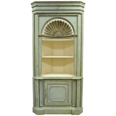 Antiqued 20th C. Shell Carved Country French Style Corner Cabinet Cupboard | From a unique collection of antique and modern corner cupboards at https://www.1stdibs.com/furniture/storage-case-pieces/corner-cupboards/