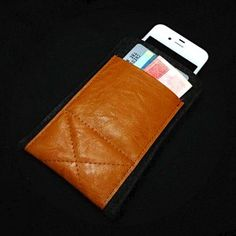 iPhone Wallet - Black Wool Felt with Light Brown Leather  Stow your credit cards and business cards along side your iPhone4S or iPhone4. Thick wool felt iPhone sleeve is saddled with pocket for your credit cards and business cards. This case is highly suggested for use with the iPhone 4S/4 but will also work with your previous generation iPhone. $25.00